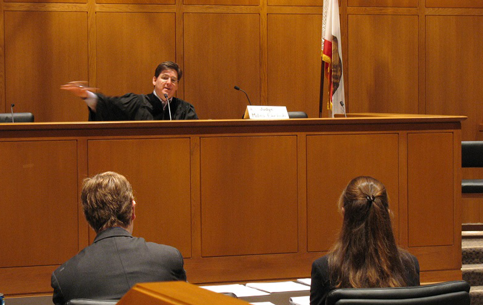 A court room with a judge and lawyers