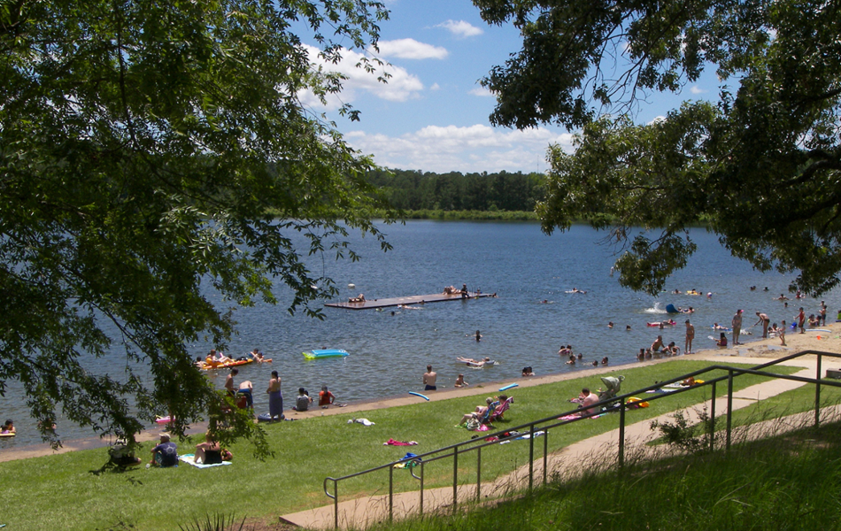 People swiming and playing in an outdoor Park